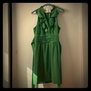 Green dress with gold buttons ruffle collar